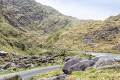 Empty Road Ireland 0017. Empty mountain road veering right then left. Location: Kerry Highlands, near Killarney and the Ring of Kerry, south west coast of Stock Photo