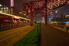 Empty road and iron tower with city landmark architecture backgr Stock Image