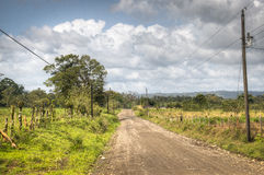 Empty road between La Fortuna and La Guaria, Costa Rica Stock Photos