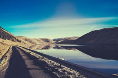 Empty Road Beside A Lake Royalty Free Stock Photos