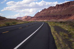 Empty road leading off into the beautiful, red mountains of Nort Royalty Free Stock Images