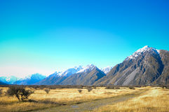Empty road leading through scenic countryside, Mount Cook National Park, New Zealand Stock Photos