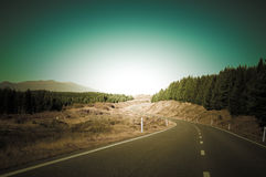 Empty road leading through scenic countryside, New Zealand. Aoraki/Mount Cook National Park is in the South Island of  Zealand, near the town of Twizel. Aoraki Royalty Free Stock Photography