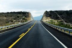 Empty road leading to the mountains royalty free stock images