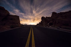 Empty Road leading towards the  rising moon Royalty Free Stock Photography