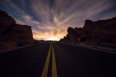 Empty Road leading towards the  rising moon Royalty Free Stock Photography