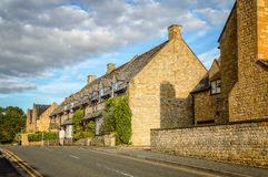 Empty road with limestone cottages Royalty Free Stock Photos