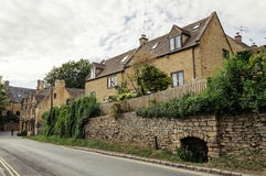 Empty road with limestone cottages Stock Photos