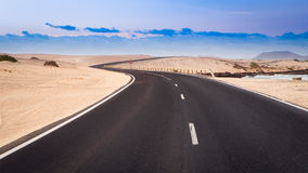 Empty road meandering. Empty road winds through the dunes near the coast Stock Image