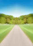 Empty Road with Motion Blur. Converging on a tree lined horizon stock photos