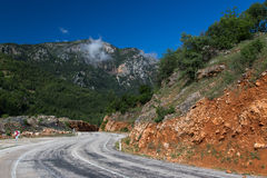 Empty road through mountains Royalty Free Stock Images