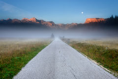 Empty road in the mountains at dawn Stock Image