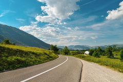 An empty road in the mountains of Montenegro. On a sunny day Royalty Free Stock Photography