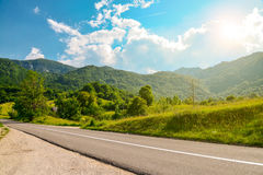 An empty road in the mountains of Montenegro. On a sunny day Stock Photo