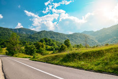 An empty road in the mountains of Montenegro. On a sunny day Stock Photography
