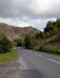 Empty road through mountains in Perthshire, Scotland Stock Image