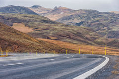 Empty Road and Moutain in Iceland. Stock Photo