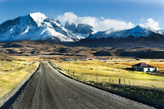 Empty road in The National Park Torres del Paine. Patagonia, Chile Royalty Free Stock Image