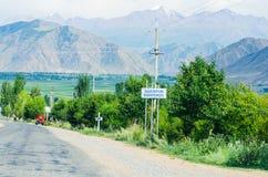 Empty road near Issyk-Kul lake Stock Photos