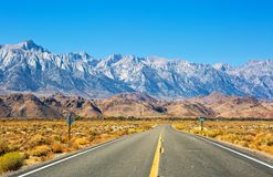 Empty road near Lone Pine with rocks of the Alabama Hills and the Sierra Nevada in the background, Inyo County, California, United. States royalty free stock photos
