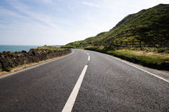 Empty road. Next to sea in County Antrim, Northern Ireland Royalty Free Stock Image