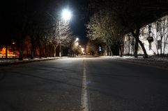 Empty road at night in europe on a background of old buildings. Empty road at night in europe on a background of old stock photography