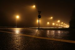 Empty road at night, lit by lanterns stock photos