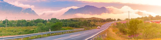 Empty road in Norway, Europe. Sunset travel Stock Photo