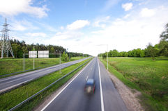 Empty road with one car motion blur Royalty Free Stock Photography