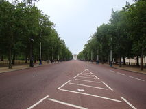 Empty road on a park in London city with trees on sides Stock Images