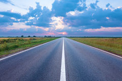 Empty road in the plain at dawn Royalty Free Stock Photography