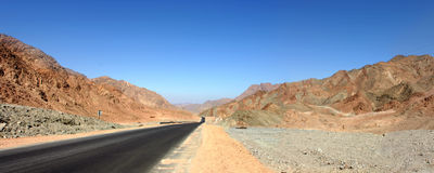 Empty road in rocky desert. Panoramic view of an empty road in the Sinai desert Stock Images