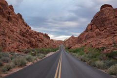 Empty road through sandstone rocks Stock Photography