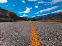 Empty road and scenic landscape in New Zealand, low angle view.  stock photos