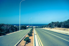 Empty road. Sea in background Royalty Free Stock Photography