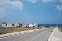 Empty road at a sea. Empty road, sea in background Stock Photos