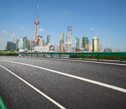 Empty road with Shanghai Lujiazui city buildings Stock Photo