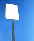 Empty road sign. Isolated in sky background Royalty Free Stock Images