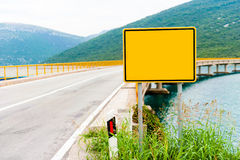 Empty road sign before the bridge.  Royalty Free Stock Photography