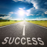 Empty road and sign symbolizing success Stock Photo