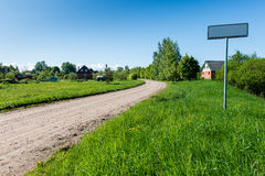 Empty road with sign for village name Stock Images