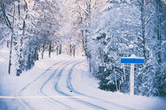 Empty road sign on winter road Royalty Free Stock Photos