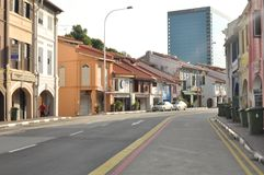 Empty road at Singapore old town. The beach road which locate old shoplots and houses in Singapore Stock Images