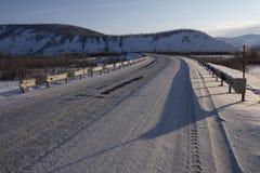 Empty road and snow around. Stock Photo