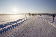 Empty road with snow coverage Royalty Free Stock Photography