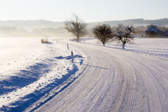 Empty road with snow coverage Royalty Free Stock Image
