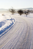 Empty road with snow coverage Stock Image