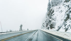 Empty road with snow covered landscape in winter season. Stock Photos