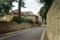Empty road with stone fences Stock Photos