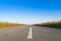 Empty road on sun with blue sky Royalty Free Stock Image